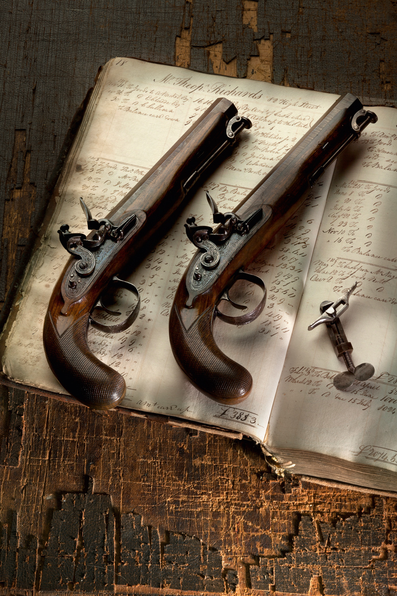 A Pair of Westley Richards 16g Flintlock Officers Pistols