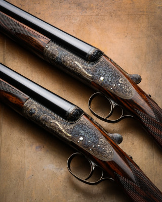Westley Richards Round Action Sidelocks. A Pair of 20g Single Trigger Guns.