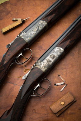 Two David McKay Brown 28g Over Under guns.