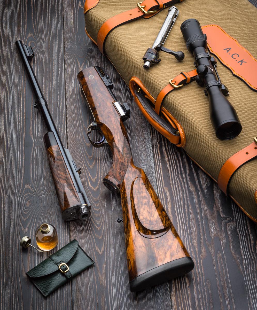 A Westley Richards .375 Take Down Rifle lies on its case.