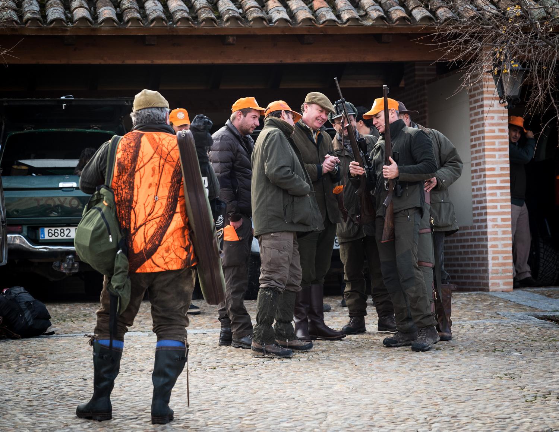Admiring rifles before the hunt.